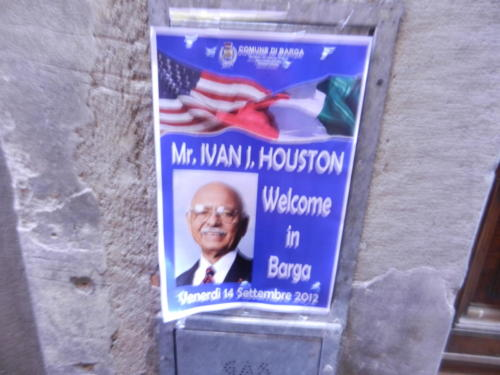 Welcome poster in Barga