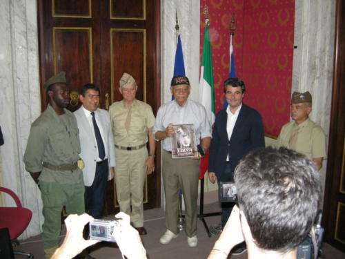 Presented honors in Lucca